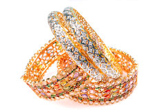 Golden bracelets and diamond bangles Royalty Free Stock Images