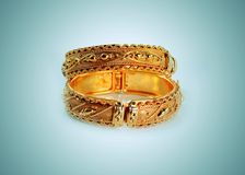 Golden bracelets fashion woman background Royalty Free Stock Photos