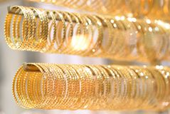 Golden bracelets stock photography