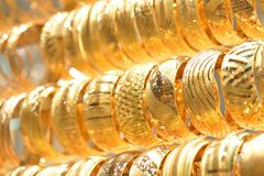 Golden bracelets royalty free stock photo