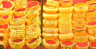 Golden bracelets Stock Images