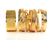 Golden bracelets stock images