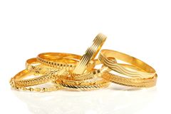 Golden bracelets Stock Photos