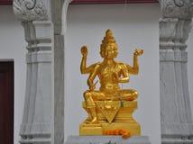 Golden Brahma sculpture in Hindi Shrine Royalty Free Stock Photo