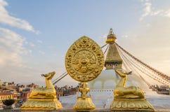 Golden brahma symbol in front of Bodhnath stupa Royalty Free Stock Photo