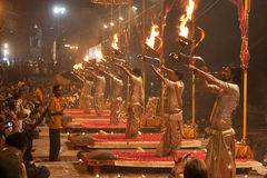 Golden Brahmins with fire. Night Puja. Ghats at the holy river of Ganga in Varanasi, Uttar Pradesh, India Stock Photo