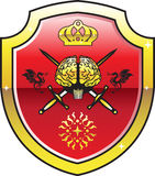 Golden brain. Shield with swords. Stock Images