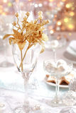 Golden branch on Christmas table. Place setting in white and golden tone Stock Photo