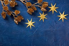 Golden branches. On a blue background stock photo