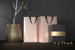 Golden branding paper shopping bag with handles and luxury black box Mock Up. Premium white package for purchases mockup. On a black background. 3d rendering stock photography
