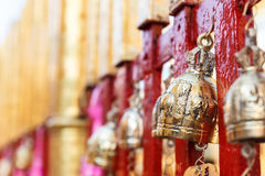 Golden brass bell hanging on the temple fence Stock Images