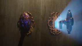 A golden brass key unlocks the old doors