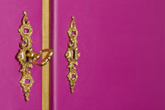 Golden brass locks with key on a purple cabinet Royalty Free Stock Photo
