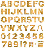 Golden or brass metal alphabet letters or font. Golden or brass metal alphabet letters, digits and punctuation marks. Font isolated on white Royalty Free Stock Photos