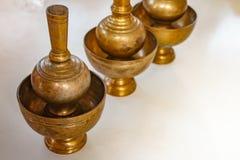 A golden brass pour ceremonial water jar. Stock Photo