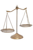 Golden brass scales of justice on white background. Royalty Free Stock Photography
