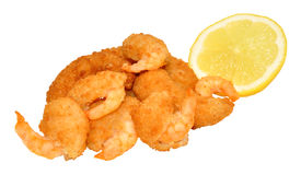 Golden Breadcrumb Coated Prawns. Golden breadcrumb coated cooked prawns with lemon isolated on a white background Stock Photo