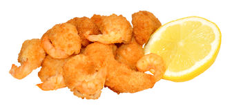 Golden Breadcrumb Coated Prawns. Golden breadcrumb coated cooked prawns with lemon isolated on a white background Stock Photography