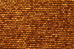 Golden brick wall Stock Photography