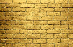 Golden brick wall background. Golden background with bronze shimmering wall of bricks stock image