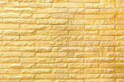 Golden brick wall background pattern texture Stock Photos
