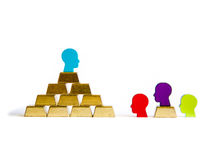 Golden bricks: wealth inequality conceptualisation. With tokens tokens Royalty Free Stock Photos