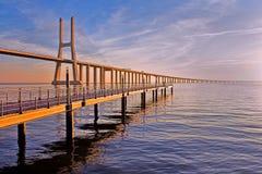 Golden bridge. Vasco da Gama Bridge at dawn Stock Photo