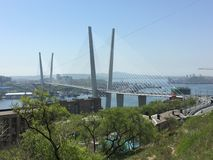 The Golden Bridge. In Vladivostok. Unusual perspective gives a perfect view on the Golden Bay as well Stock Photo