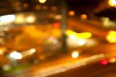 Golden bright lights on dark night background Stock Photos
