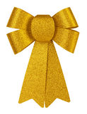 Golden brilliant gift bow with glitter close-up isolated on a white background. Royalty Free Stock Photos