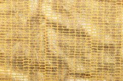 Golden brocade background Stock Photos