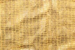 Golden brocade background Royalty Free Stock Photos