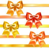 Golden and bronze bows of silk ribbon Stock Images