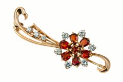 Golden brooch with garnet and  brilliants Royalty Free Stock Photos