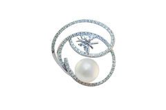 Golden brooch with pearls and diamonds stock image