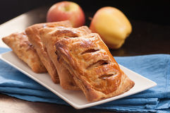 Golden brown apple turnovers Royalty Free Stock Image