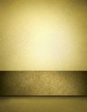 Golden brown background with copy space. Gold background with elegant warm brown tones with darkened stripe, burnt edges, fine high texture and copy space to add Royalty Free Stock Photography