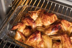 Golden brown chicken wings are still in the oven Royalty Free Stock Photos