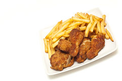 Golden brown fried chicken served with fries Royalty Free Stock Photography