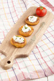 Golden brown potato cake on wooden board Stock Images