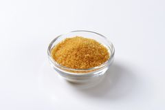 Golden brown raw cane sugar Stock Image