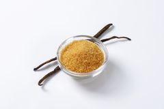 Golden brown raw cane sugar Royalty Free Stock Images