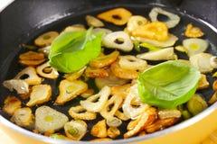 Golden brown sliced garlic Stock Images