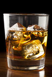 Golden Brown Whisky on the rocks Royalty Free Stock Photos