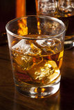 Golden Brown Whisky on the rocks. In a glass Royalty Free Stock Photos