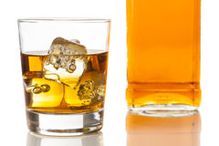 Golden Brown Whisky on the rocks Stock Images