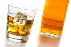 Golden Brown Whisky on the rocks Royalty Free Stock Images