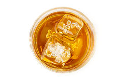Golden Brown Whisky on the rocks. In a glass Royalty Free Stock Photography