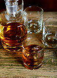 Golden Brown Whisky on the rocks in a glass Stock Image