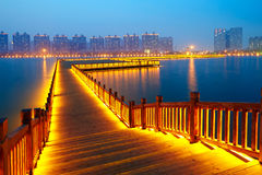 Golden brown wooden footway in night Royalty Free Stock Photos